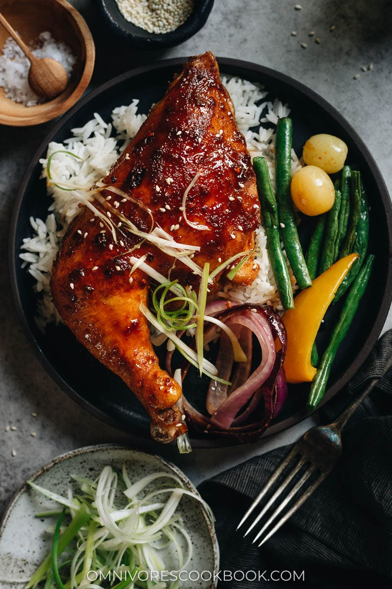 Honey soy glazed chicken thigh over rice with roasted vegetables
